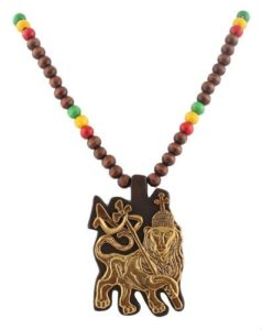 Brown and gold tone lion of Judah rasta pendant