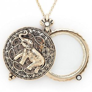 Filligree gold tone glass magnifier pendant